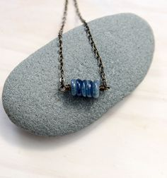 This necklace includes five kyanite gemstones to symbolize five deep breaths. Each time you see them, let them be a reminder to you to pause and take those deep breaths. Kyanite invites you to speak your truth.
