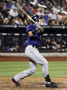 Colorado Rockies' Tyler Colvin watches his solo home run during the fifth inning of a baseball game against the New York Mets, Monday, Aug. 20, 2012, at Citi Field in New York. (AP Photo/Seth Wenig)