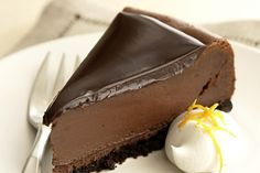Deliciously Dark Chocolate Cheesecake - It doesn't get better than lush layers of creamy cheesecake and chocolate ganache in a crust of chocolate wafer cookies.