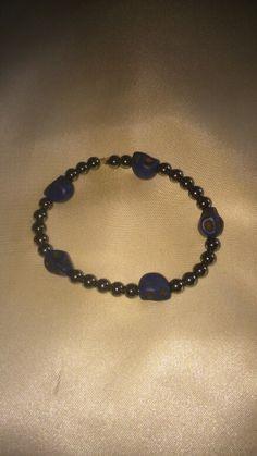 Hematite beads and blue skull