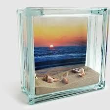 Photo Fillable glass block found at craft stores Ruler Scissors Sand and Seashells, or other vacation mementos How to Make it: Print your pictures on the KODAK Picture Kiosk. Trim photo to fit inside block. Secure top of photo to inside of bl Seashell Art, Seashell Crafts, Beach Crafts, Diy Crafts, Wood Crafts, Seashell Display, Crafts With Seashells, Glass Block Crafts, Seashell Projects