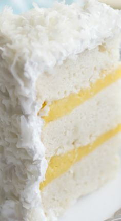 Coconut Cake ~ A towering triple-layer beauty, with white cake made with coconut oil and coconut milk, coconut milk pastry cream filling, a fluffy, marshmallow-y seven minute frosting, and mounds of sweet shredded coconut.