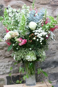 Rustic vase of beautiful blooms for a July wedding at Wedderburn Castle. Contact The Stockbridge Flower Company, Edinburgh for more details
