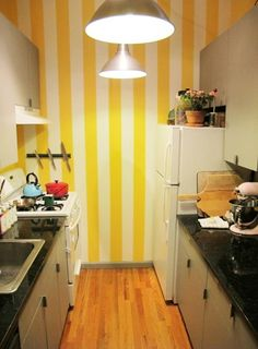 hey, Landrum, check out the yellow stripes with white cabinets and black countertop. so pretty. Dark Granite Countertops, How To Clean Granite, Yellow Interior, Kitchen Paint Colors, Striped Walls, Yellow Stripes, White Cabinets, Interiores Design, Kitchen Design