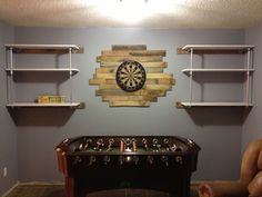 Pallet board surround for the dart board. I love how this turned out!!! Man Cave!