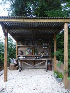 An outdoor kitchen for my man... love the painting of Clint!  Jacob Cottage UK
