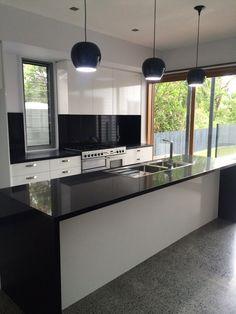 Amazing kitchen renovation- Ceaserstone benchtops & concrete floors!