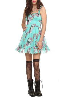Aqua chiffon dress with ruffle accents, elastic side panels, full lining and a floral skull print.