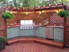 Modern outdoor kitchen with wood gazebo