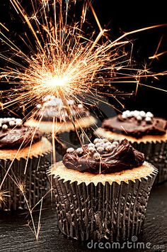 Photo about Cupcakes decorated with chocolate ganache with sparklers. Image of cake, silver, cupcakes - 18709828 New Years Eve Day, New Years Party, New Year's Cupcakes, Cupcake Cakes, Party Cupcakes, Gold Cupcakes, Gourmet Cupcakes, Yummy Cupcakes, Birthday Cupcakes