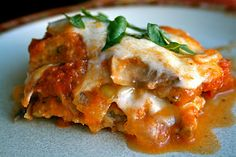 Healthy eggplant parmesan...eggplant slices are baked instead of fried. Also includes caramelized onions and pesto!