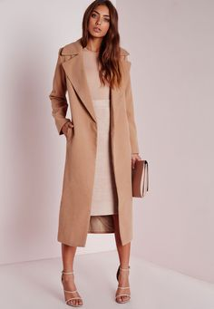 Up your coat game this season and work some Kimmy K vibes in this seriously chic camel wool coat. In a luxe longline fit with pockets to the sides this coat is what we're vibin' all over. Style over a figure flattering nude bodycon dres...