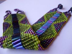 Beadweaving... uses seed beads and/or crystals, and be done either on a loom or without. This is beautiful.