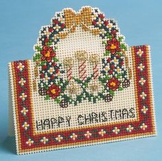 This cross stitch kit makes for a richly coloured and lavish looking Christmas card, especially when arranged as a 3D design from The Nutmeg Company....