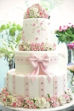 Beautiful Wedding Cake With Hints of Pink and Green <3<3