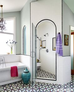 """I like to blur boundaries,"" says designer Karen Vidal. The tile she chose for this 1970s beach house bathroom is similar to that of a cement floor in Spain, but the pattern is based on a block print from India.   - HouseBeautiful.com"