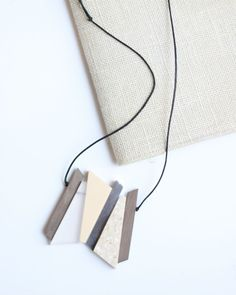 Clear and Cream Resin and Wood Necklace by Sylca
