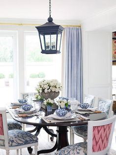love the lantern chandelier and the chair backs in pink
