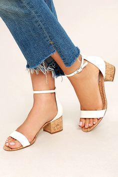 Classic and cool, the Steve Madden Irenee C White Cork Ankle Strap Heels will maintain your laid-back persona! White faux leather shapes a single toe strap and adjustable ankle strap (with silver buckle) atop a cork-wrapped single sole design.
