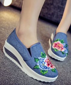 Lift ensembles to new heights with this canvas platform shoe that features vibrant nature-inspired embroidery and a nonslip rubber sole.2'' heelCanvas upperRubber soleImported