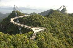 Langkawi Sky Bridge, Malaysia. A marvel of modern engineering, the curving bridge deck allows visitors an intimate experience of the forest canopy and wildlife. And from the built-in triangular lookout decks visitors get panoramic views of Langkawi...