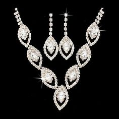 """Bridal Wedding Jewelry Set Crystal Rhinestone Navette Design V Drop Silver Accessoriesforever. $18.50. Material: Clear Crystal Rhinestones, Metal Casting, Rhodium / Silver Plated. Color: Silver, Clear. Dimensions (Size): Necklace Length: 12"""" + 6"""" Extender (Lobster Claw Closure); Earrings: Approx. 1.85"""" Drop x 0.7""""W (Post Back Closure). Style: Navette Cut Design, Prong Set. Quantity: 1 set includes 1 necklace and matching earrings. Nickel & Lead Free"""