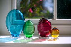 freeblown jewel-coloured glass eggs in the spring sunshine by Emsie Sharp for Velvet & Dash