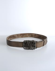 Leave it up to #Margiela to bring something inspiring and artsy to the table. The wire wrapped buckle and vintaged #leather #belt is a perfect match with your favorite pair of beat-up jeans for that #rustic look. @MMM_Official
