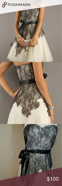 Lace overlay evening / prom dress Knee length strapless a-line dress by Max and Cleo. Style: MGZ6Q975-104  Details: Lace Embellished, Side Bow, A-Line Length: Short Neckline: Strapless Sweetheart Waistline: Natural Max & Cleo Dresses