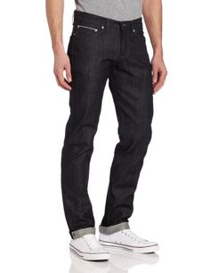 Zip fly and button closure 13 oz. Japanese selvedge denim This Naked & Famous jean features five-pocket styling, a dark wash, and a classic fit.