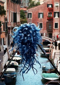 """I remember this so well. I went to Venice that year...It was spectacular!!! """"One of Dale Chihuly's """"Chandeliers"""" hangs over the canals of Venice, Italy in 1996, part of the vast installation, """"Chihuly Over Venice."""" (A..."""