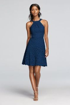 The cutaway Y-neckline on this short lace bridesmaid dress gives you a balanced silhouette. The scalloped hem adds a sweet touch. Front y-neck with tank straps in back. Above the knee skirt length with scalloped hem. Fully lined. Imported. Back zip. Dry clean only. To protect your dress, try our Non Woven Garment Bag.
