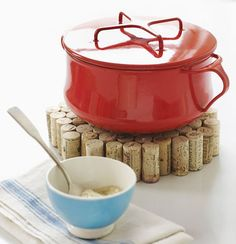 We have seen many DIY projects featuring uses for corks, but often times the overall effect is rather shabby chic or country kitchen. While that may suit some decors, it's nice to see a more pared down version that with clean lines and simple shape, that would fit in with a more minimalist look. This DIY cork trivet from Sweet Paul is simple, easy and would fit in on most tables.