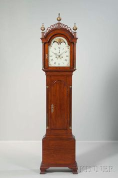 Walnut Tall Case Clock, possibly Pennsylvania, late 18th century, case with brass-mounted reeded and stop-fluted hood and waist quarter-columns flanking the painted tombstone dial showing phases of the moon, calendar aperture, thumb-molded tombstone door below, all on ogee bracket feet, (restoration), ht. 87 1/2 in.