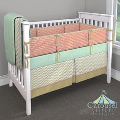 Crib bedding in White and Gold Dot, Solid Mint Minky, Solid Light Coral, White and Gold Chevron, Solid Gold Satin, Light Coral Wave. Created using the Nursery Designer® by Carousel Designs where you mix and match from hundreds of fabrics to create your own unique baby bedding. #carouseldesigns