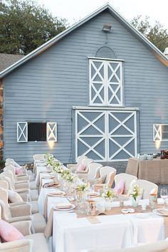 Lovely chic reception - really like the soft blue color of the barn as backdrop for the reception #wedding #farmhouse #rustic #reception #barnwedding