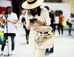 What Your Bag-Carrying Style Is Secretly Communicating via @WhoWhatWear