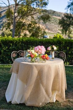 burlap sweetheart table wedding decor / http://www.deerpearlflowers.com/rustic-wedding-ideas-with-burlap-touches/