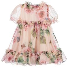 Baby girls gorgeous Mini-me, rose-printed pink dress from Dolce & Gabbana, made in luxurious silk chiffon. Fully lined in viscose satin, it has delicate ruffled trim and fastens with a concealed zip at the back. It comes with a matching pair of satin knickers and a branded fabric cover bag.