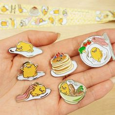 "Thank you and congratulations to everyone who completed their Pin Collector's Stamp Card at London MCM Comic Con and claimed their exclusive ""Dinner Plate"" enamel pin! There's still time to grab your Gudetama pins tomorrow, we have five designs available to purchase and one to win, plus a Gudetama lanyard which you can display them on"