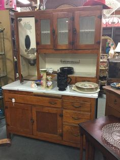 Vintage Hoosier with sugar jar and 5 spice jars, in good condition. From dealer 155 in booth 103. Priced at $895.00 12419 N 28th Dr Phx, AZ 85029 602.942.0030