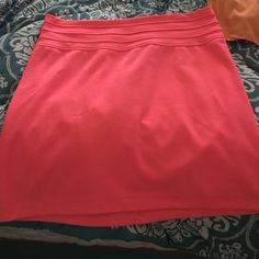 A skirt It is a hot pink color and can be worn on a night out with friends and other places. It is made with 90% polyester, 7% rayon, 3% spandex. For care: machine wash cold with like colors on gentle cycle. Charlotte Russe Skirts Midi