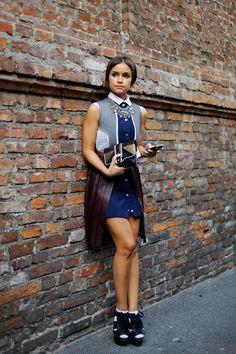 MD, Milan, wearing a stellar combination of a J.W. Anderson dress, Paula Cademartori clutch and Burberry platform sandals.