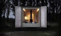 "This is the eco-friendly Ark Shelter ""Shelter S"" that resembles a modern and chic shipping container tiny house. Come check it out! Prefabricated Cabins, Prefab Homes, Modular Homes, Home Design, Design Ideas, 55 Gallon Plastic Drum, Casa Patio, Off Grid Cabin, Rain Barrel"