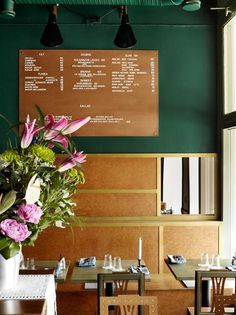 Stockholm's Bar Central, with a green wall painted a color similar to Devine Spruce or Devine Fir.  #devinecolor #paint