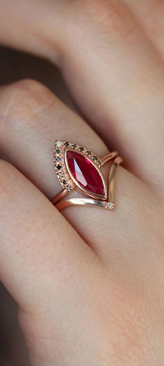 A gorgeous ring set with a marquise ruby engagement ring with black diamonds and a matching wedding Ruby Wedding Rings, Classic Wedding Rings, Gold Diamond Wedding Band, Rose Gold Engagement Ring, Ruby Rings, Ear Rings, Gold Jewelry Simple, Gold Rings Jewelry, Jewelry Design Earrings
