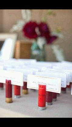 Great idea bullet shells as seating place holders!  Would be perfect for a country, rustic wedding.