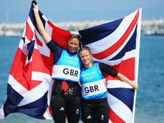 Brits Hannah Mills and Saskia Clark celebrate after taking the silver medal in the 470 class at Weymouth.