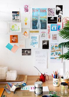 love this art wall for a workspace
