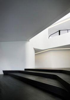 dark floors contrasting the white